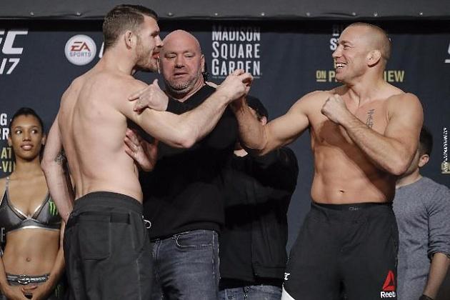 Падение чемпионов UFC: Сен-Пьер «удушил» Биспинга, Диллашоу нокаутировал Гарбрандта